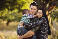 Family and soldier in a military uniform. Say goodbye before a separation royalty free stock photo