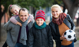 Family with son and daughter. Autumn outdoor portrait of european family with son and daughter stock photo