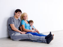 Family with son in empty room Stock Image
