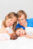 Family with son and newborn daughter. Portrait of happy family with son and newborn daughter Stock Images
