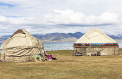 FAMILY AT SONG KUL LAKE IN KYRGYZSTAN. This photo was taken on July, 2015 in Songkul lake, Kyrgyzstan. Song Kul is a high alpine lake in the Tian Shan Mountains stock image