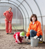 Family sows seeds at greenhouse Royalty Free Stock Image