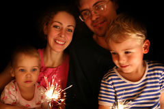 Family with sparkler Royalty Free Stock Images