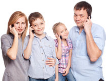 Family, speaking on the phone. Parents with children with mobile phone Royalty Free Stock Photo