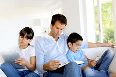 Family spedning time together but separately Stock Photography