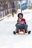 Family speeding on a sledge Stock Photo