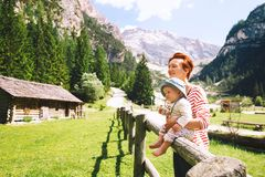 Family spend summer holiday in Dolomites, South Tyrol, Italy, Eu. Mother and baby with mountains on a background. Family spend summer holiday in Dolomites, South royalty free stock photos