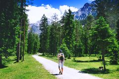 Family spend summer holiday in Dolomites, South Tyrol, Italy, Europe. Family on trekking day in the mountains. Mother and child on nature. Tourists travel at stock photography