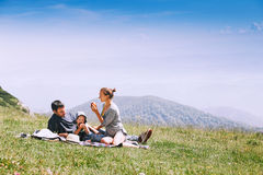 Family spend time on nature in the mountains. Royalty Free Stock Image