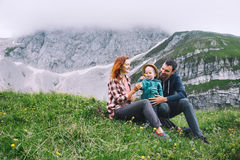 Family spend time on nature in the mountains. Royalty Free Stock Photography