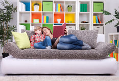 Family spend time to reading a book Royalty Free Stock Photo