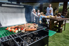 Family spend time together at barbecue Stock Photo