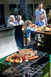 Family spend time together at barbecue Royalty Free Stock Images