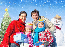 Family Spending Christmas In The Snow Stock Image