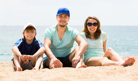 Family spending free time on the beach Stock Images