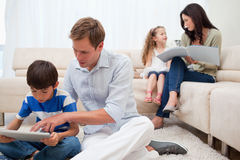 Family spending spare time in the living room stock images