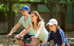 Family spending their summer vacation with bicycles. Active family spending their summer vacation on the street with bicycles Stock Photography