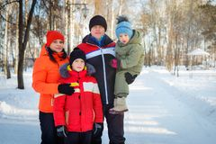 Family spending time outdoor in winter. Happy young family spending time outdoor in winter stock photography