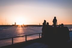 Family spending time during the sunset by the sea stock photo