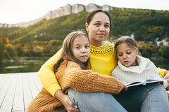 Family spending time together by the lake Royalty Free Stock Photos