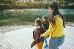 Family spending time together by the lake Stock Photos