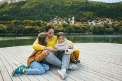 Family spending time together by the lake Royalty Free Stock Photo