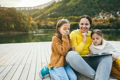 Family spending time together by the lake Stock Images