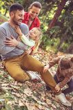 Family spending time together, tickling father is fun. Happy young family Royalty Free Stock Photos