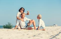 Family spent vacation time on desert sand sea beach Stock Photo