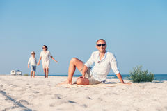 Family spent vacation time on deserted sea beach Stock Images