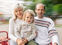 Family on spinning roundabout Stock Photography