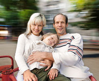 Family on spinning roundabout Royalty Free Stock Photo