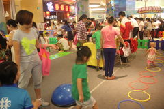 Family Spiritual Activities in the SHENZHEN Tai Koo Shing Commercial Center Stock Photography