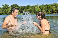 Family splashing in lake Royalty Free Stock Photos