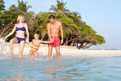 Family Splashing In The Sea On Tropical Beach Holiday Royalty Free Stock Photo