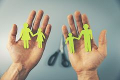 Family split after divorce concept. Paper family in hands royalty free stock images