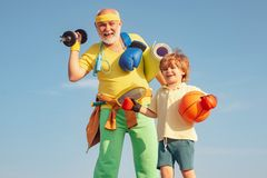 Free Family Sport. Grandfather And Grandson With Basketball Ball And Yoga Mat In Hands. Senior Man And Child In Family Health Royalty Free Stock Photos - 161147268