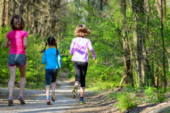 Family sport, happy active mother and kids jogging outdoors Royalty Free Stock Image