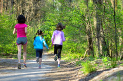 Family sport, happy active mother and kids jogging outdoors Stock Photo
