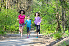 Family sport, happy active mother and kids jogging outdoors Royalty Free Stock Photography