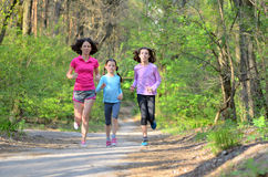 Family sport, happy active mother and kids jogging, running in forest Royalty Free Stock Image