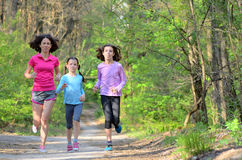 Family sport, happy active mother and kids jogging, running in forest Stock Image