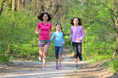 Family sport, happy active mother and kids jogging, running in forest. Family sport, happy active mother and kids jogging outdoors, running in forest stock photography