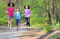 Family sport, happy active mother and kids jogging, running in forest Royalty Free Stock Photography