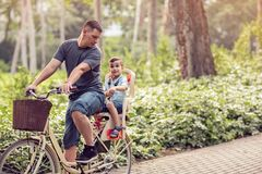 Family sport and healthy lifestyle- father and son riding a bicy Stock Image