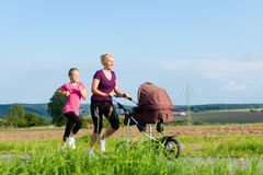Family sport - jogging with baby stroller Stock Image