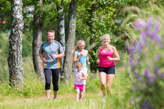 Family sport jogging through field Royalty Free Stock Photos