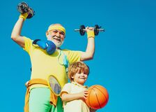 Family sport. Like sports. Fathers day. Healthy family lifestyle. Grandfather and child is doing sport outdoors. Healthy