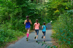 Family sport, mother and kids jogging outdoors. Running in park Stock Photography