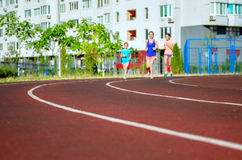 Family sport, mother and kids jogging on track Royalty Free Stock Images